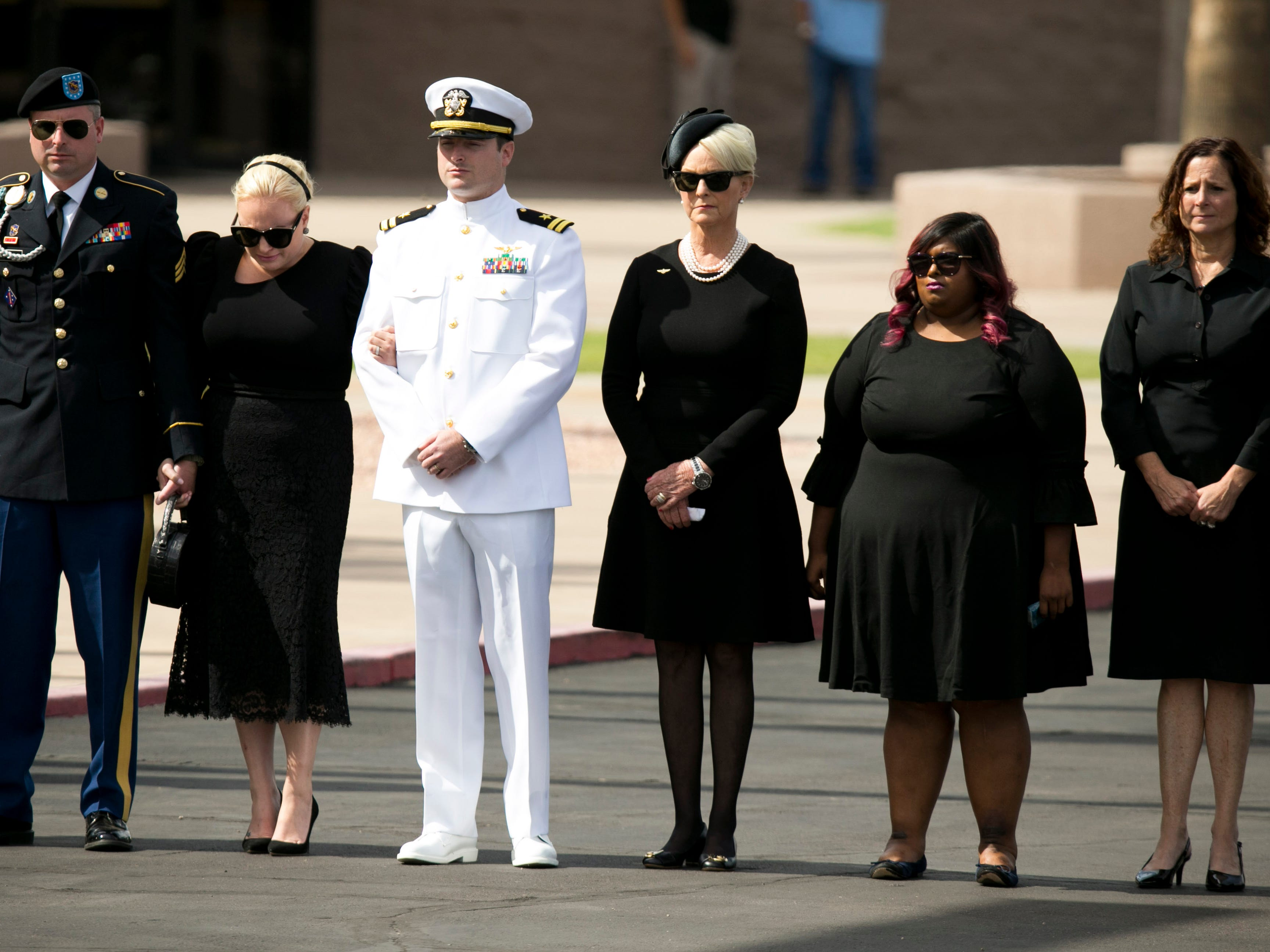 Sen. John McCain's family, from left, Jimmy McCain, Meghan McCain, Jack McCain, Cindy McCain, Bridget McCain and Sidney McCain, stand together before a memorial service at the North Phoenix Baptist Church in Phoenix, Aug. 30, 2018.