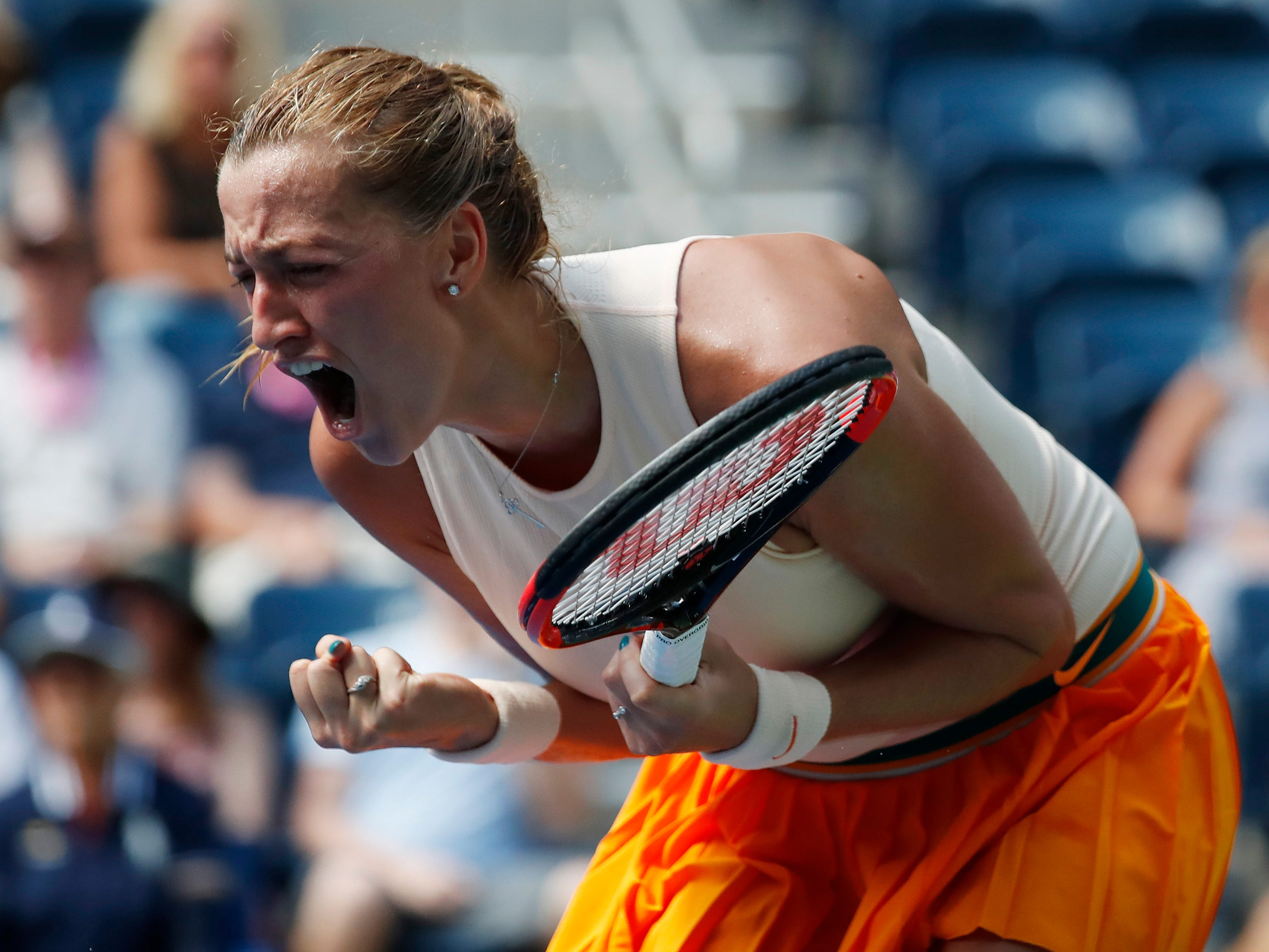 Petra Kvitova of Czech Republic celebrates after winning the first set against Yafan Wang of China.