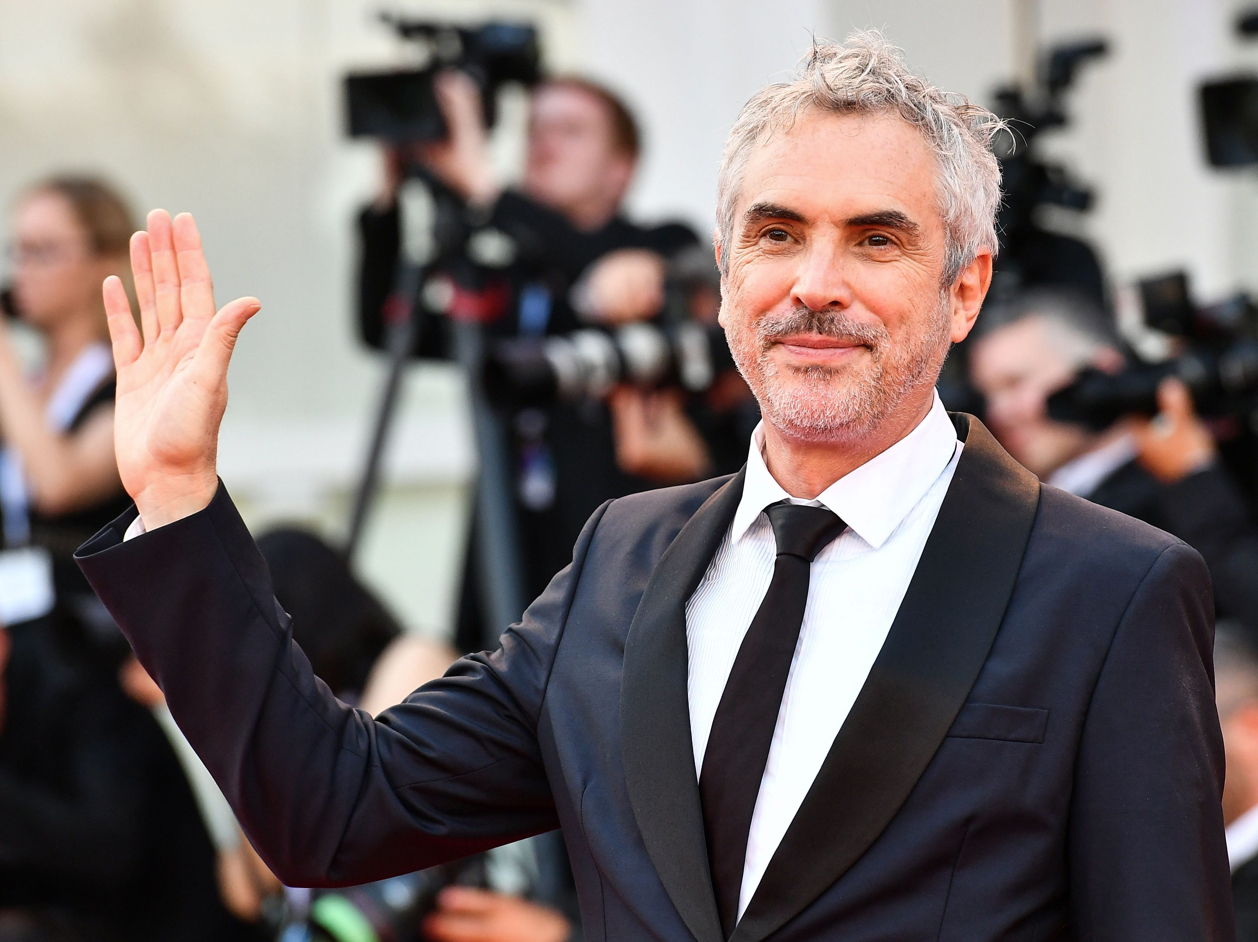 """Director Alfonso Cuaron arrives for the premiere of the film """"Roma"""" presented in competition on August 30, 2018 during the 75th Venice Film Festival at Venice Lido. (Photo by Vincenzo PINTO / AFP)VINCENZO PINTO/AFP/Getty Images ORIG FILE ID: AFP_18Q1H6"""