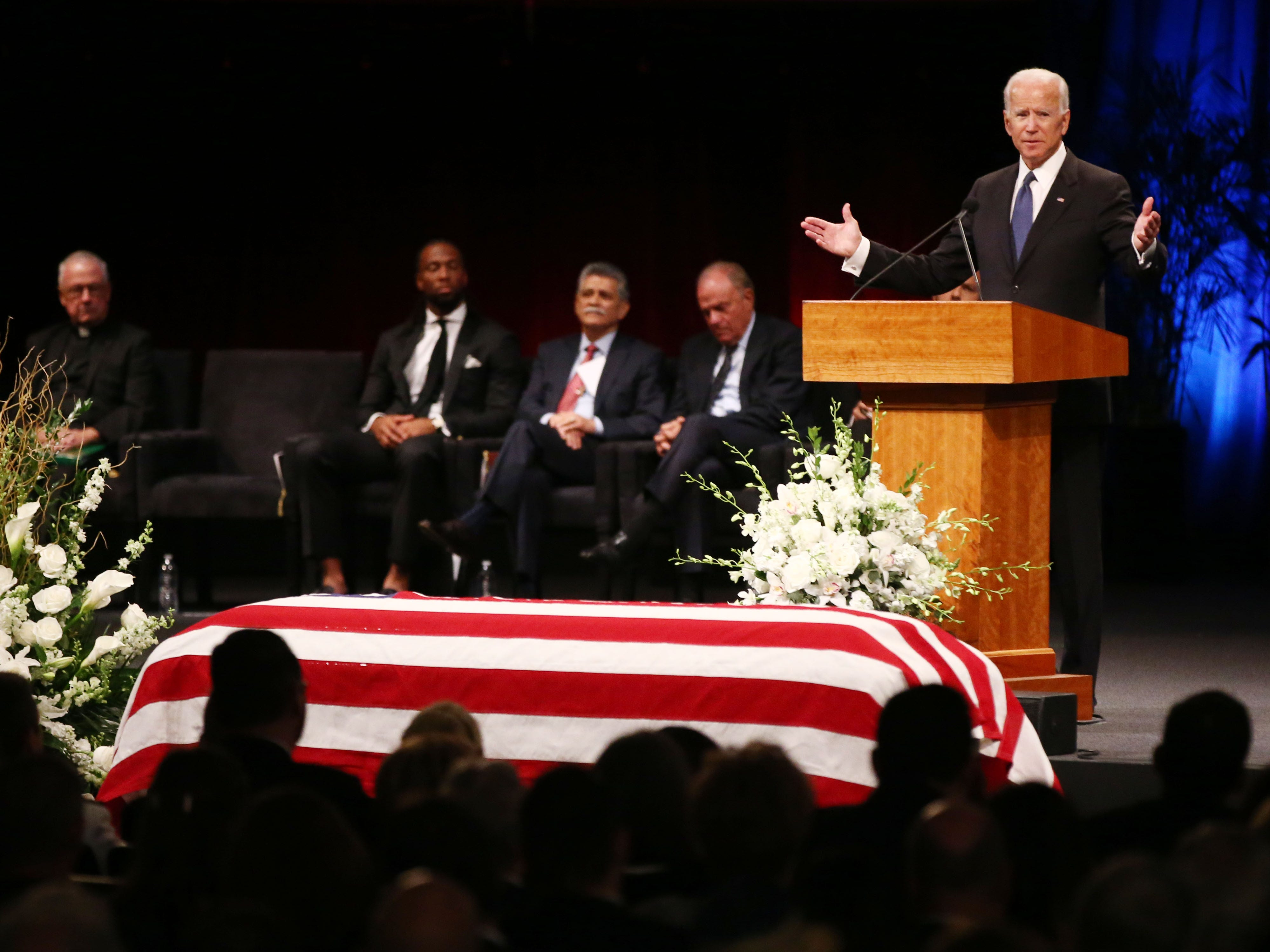 Former Vice President Joseph Biden pays tribute to his friend, Sen. John McCain, during a memorial service at North Phoenix Baptist Church, Aug. 30, 2018, in Phoenix.