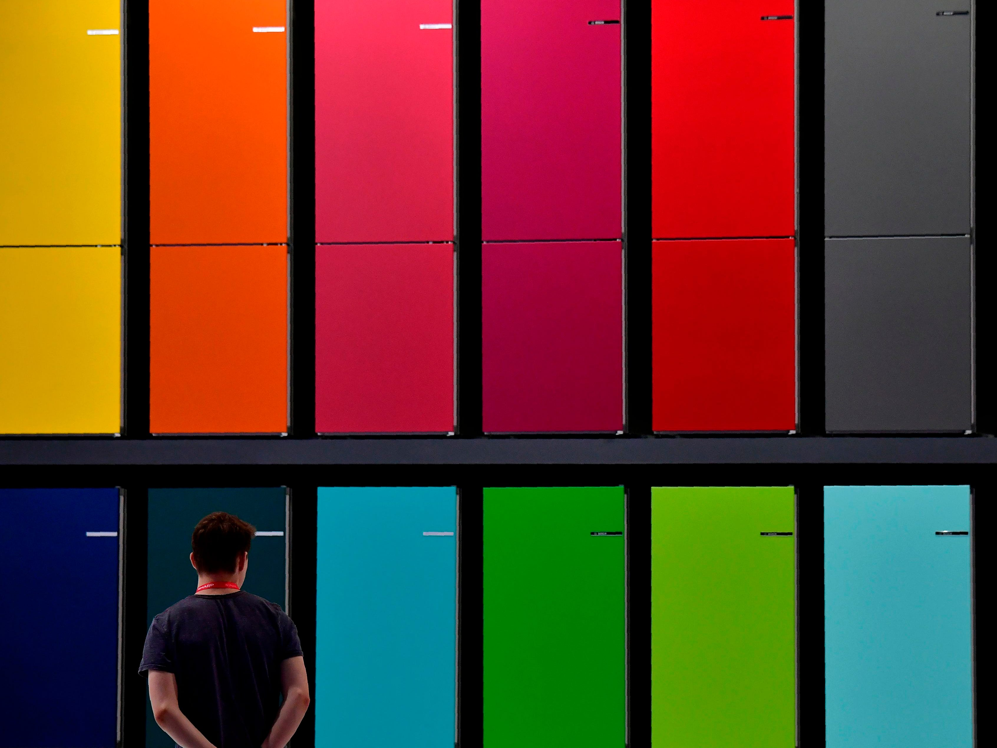 A workers passes by the Bosch booth with fridges on view, prior to the upcoming IFA, the world's leading trade show for consumer electronics and home appliances, in Berlin on August 29, 2018. (Photo by Tobias SCHWARZ / AFP)TOBIAS SCHWARZ/AFP/Getty Images ORIG FILE ID: AFP_18O7AX