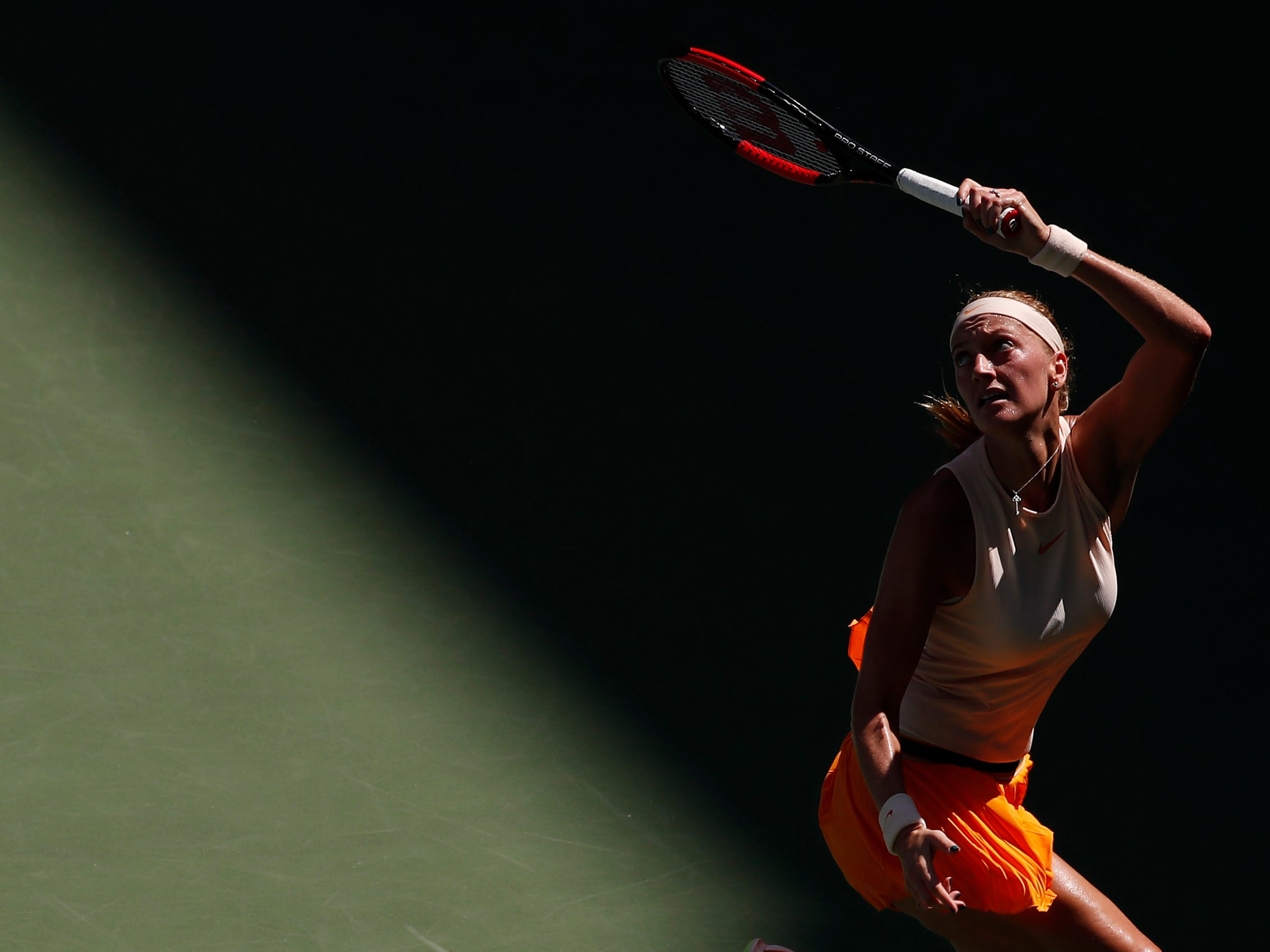 Petra Kvitova of Czech Republic hits a forehand against Yafan Wang of China.