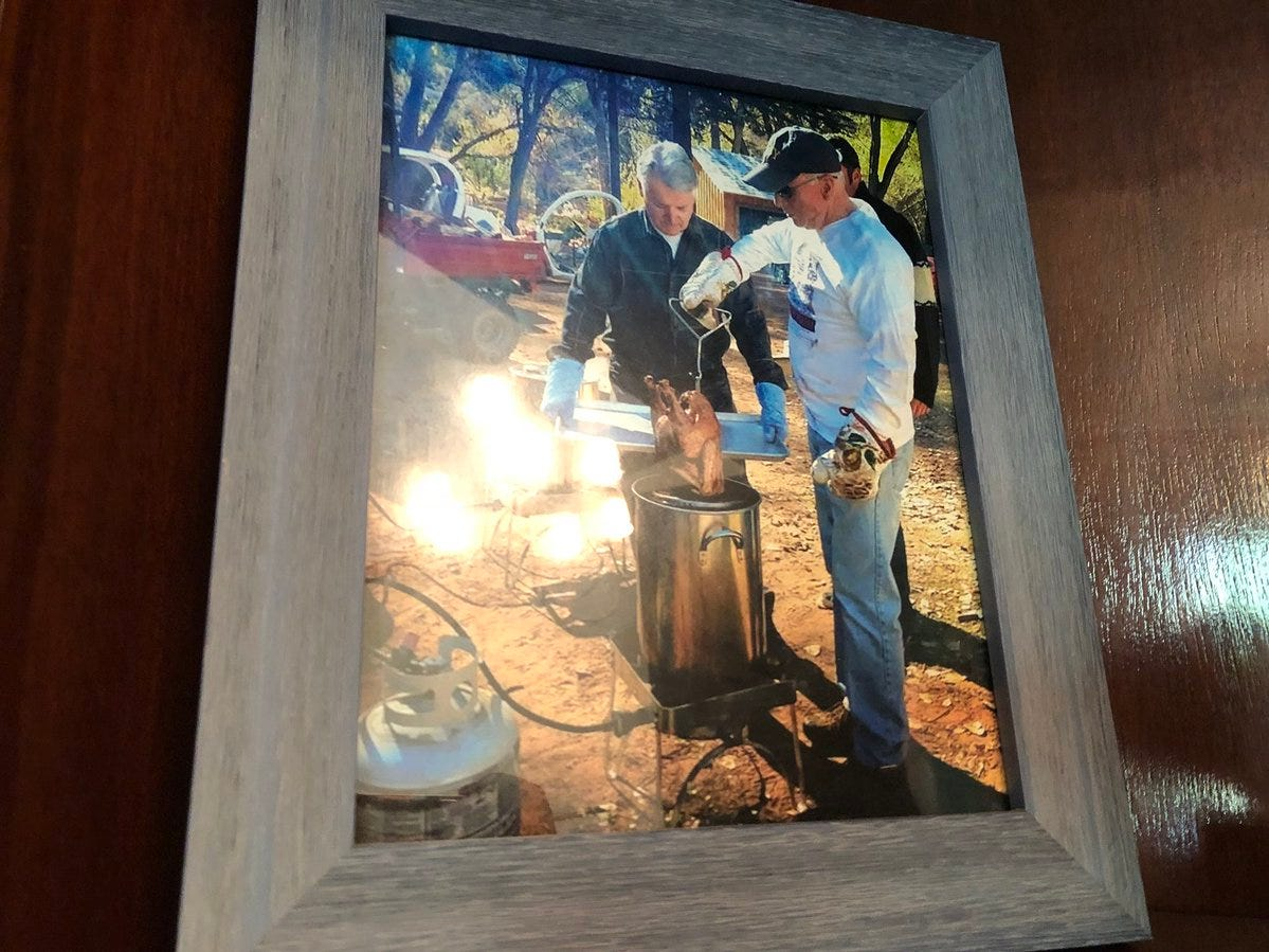 John McCain's D.C. office is filled mementos, including a photo of his deep frying a turkey.