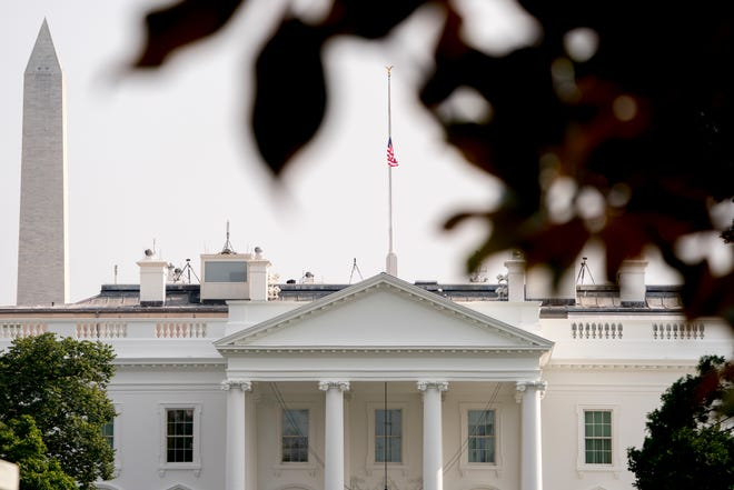 The American flag files at half-staff at the White House, Monday afternoon, Aug. 27, 2018, in Washington. (AP Photo/Andrew Harnik) ORG XMIT: DCAH203