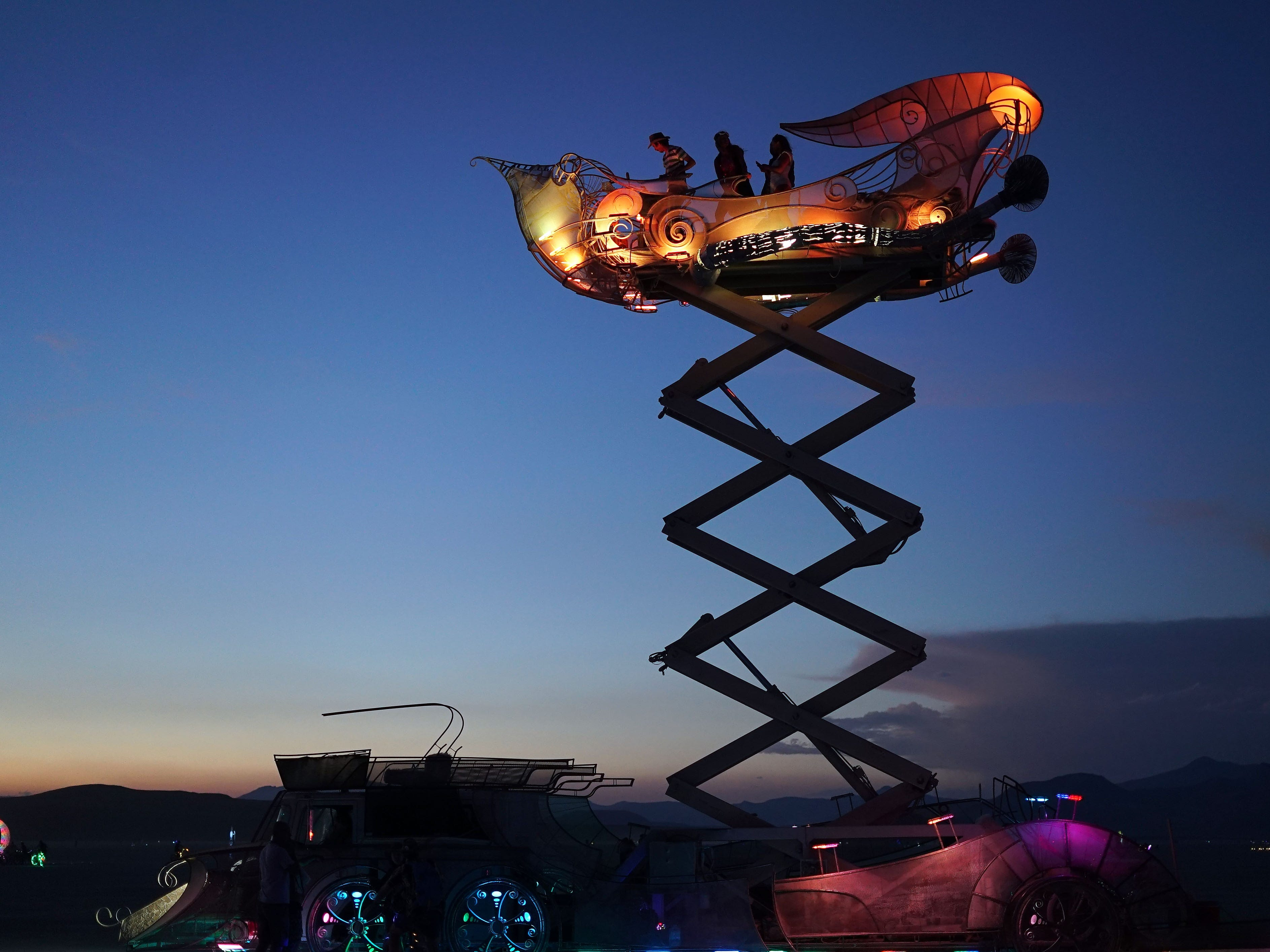 A DJ plays music from an elevated platform at Burning Man Aug. 30, 2018.