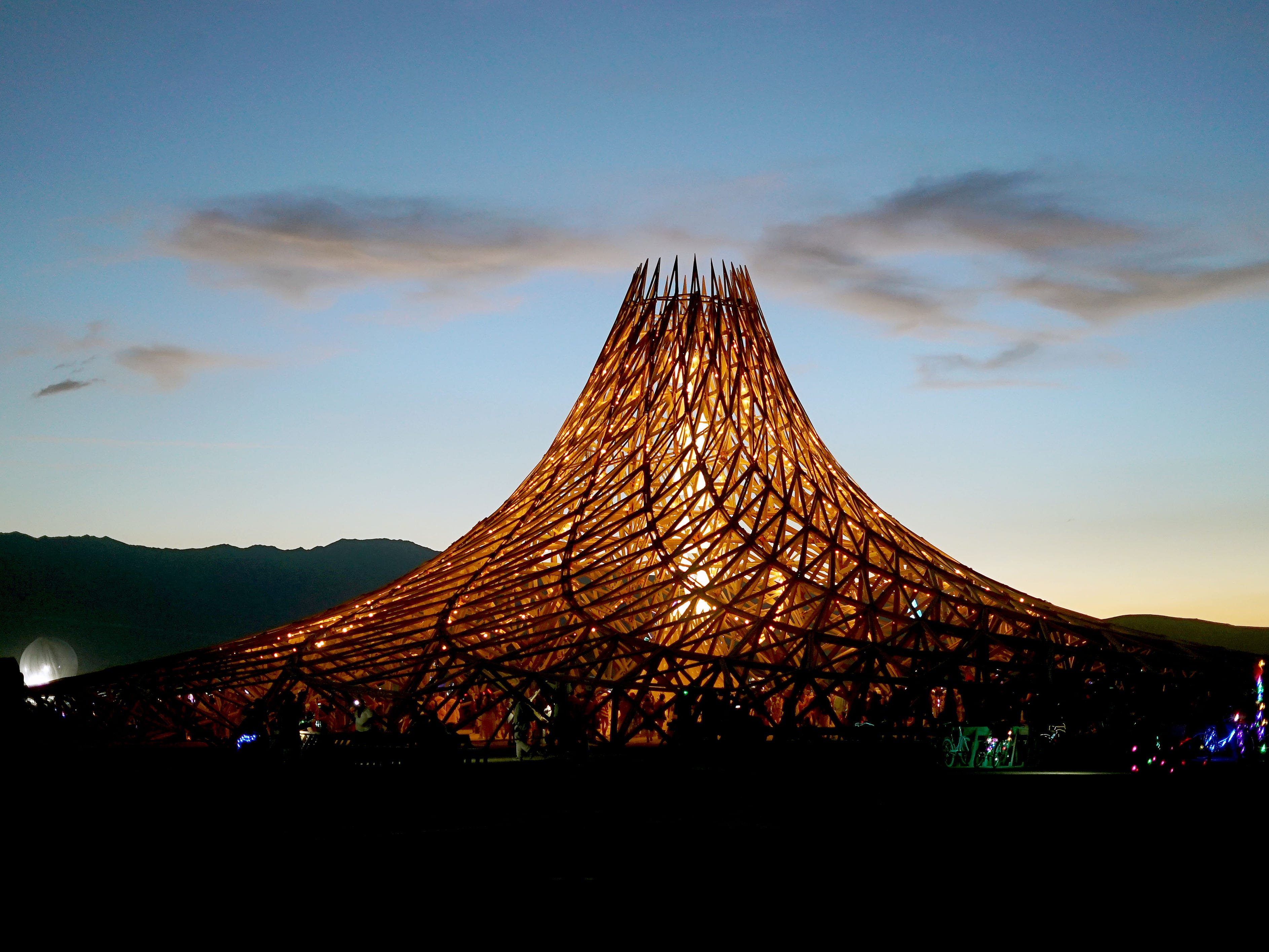 The finally completed Temple at Burning Man takes its cues from fractals and 3-D printing to offer an unusual shape and construction style, which took longer that many attendees expected. The building with be torched and burned to ashes on Sunday night.