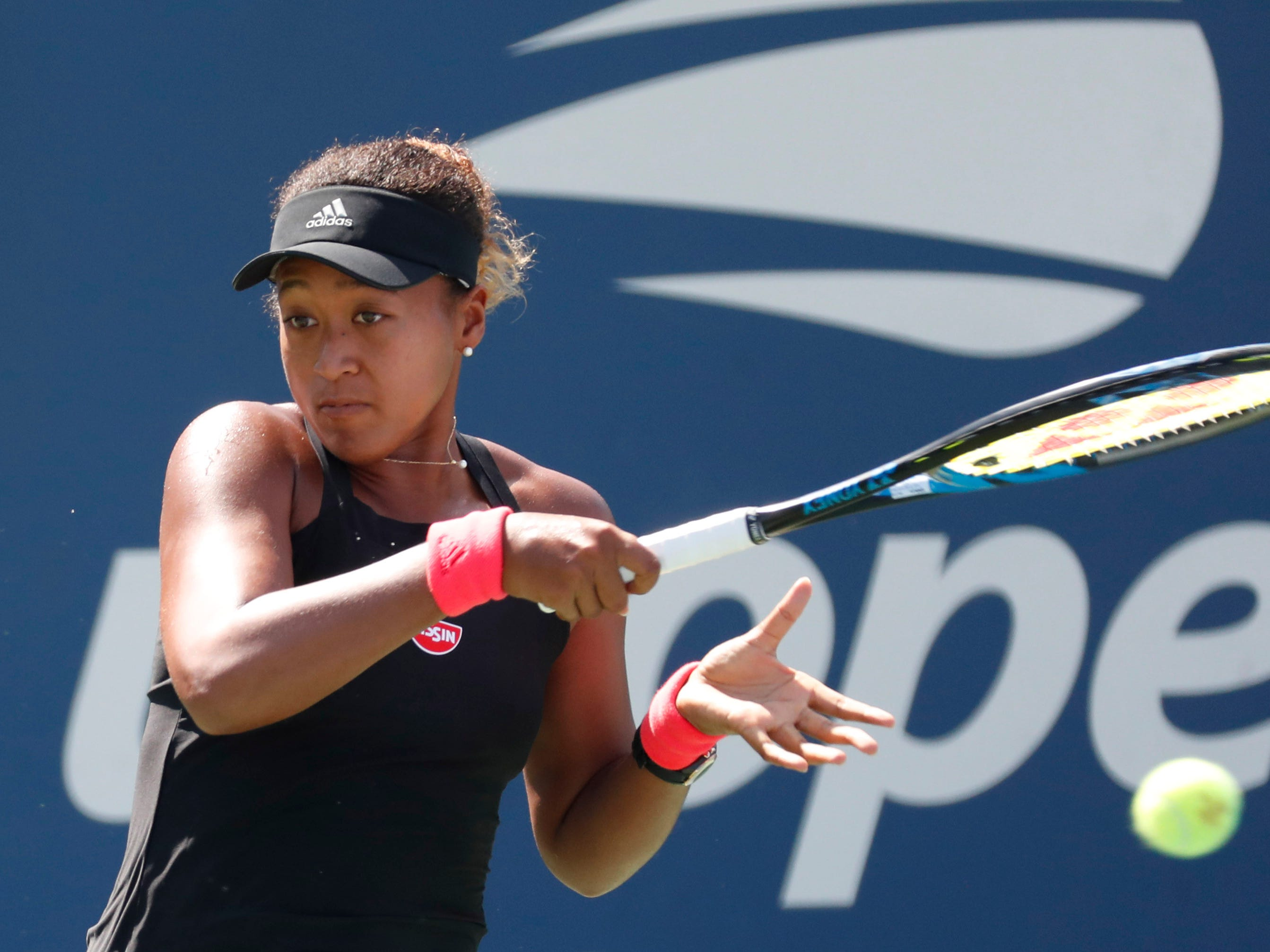 Naomi Osaka of Japan hits to Julia Glushko of Israel.