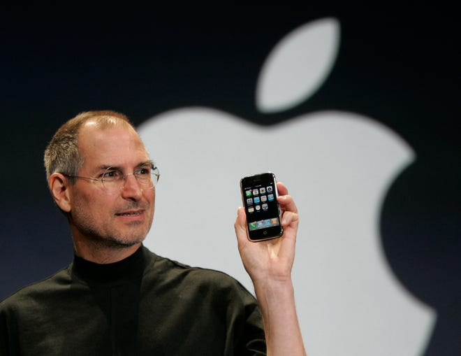 Apple CEO Steve Jobs holds up the new iPhone on Jan. 9, 2007.
