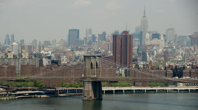 The Brooklyn Bridge, midtown Manhattan, the Empire State Building and East River are seen in this view of the New York City skyline.