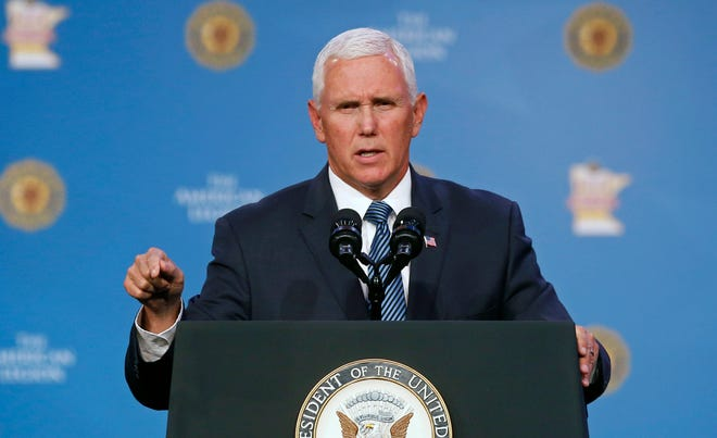 Vice President Mike Pence addresses the American Legion's 100th national convention, Thursday, Aug. 30, 2018, in Minneapolis. (AP Photo/Jim Mone) ORG XMIT: MP103