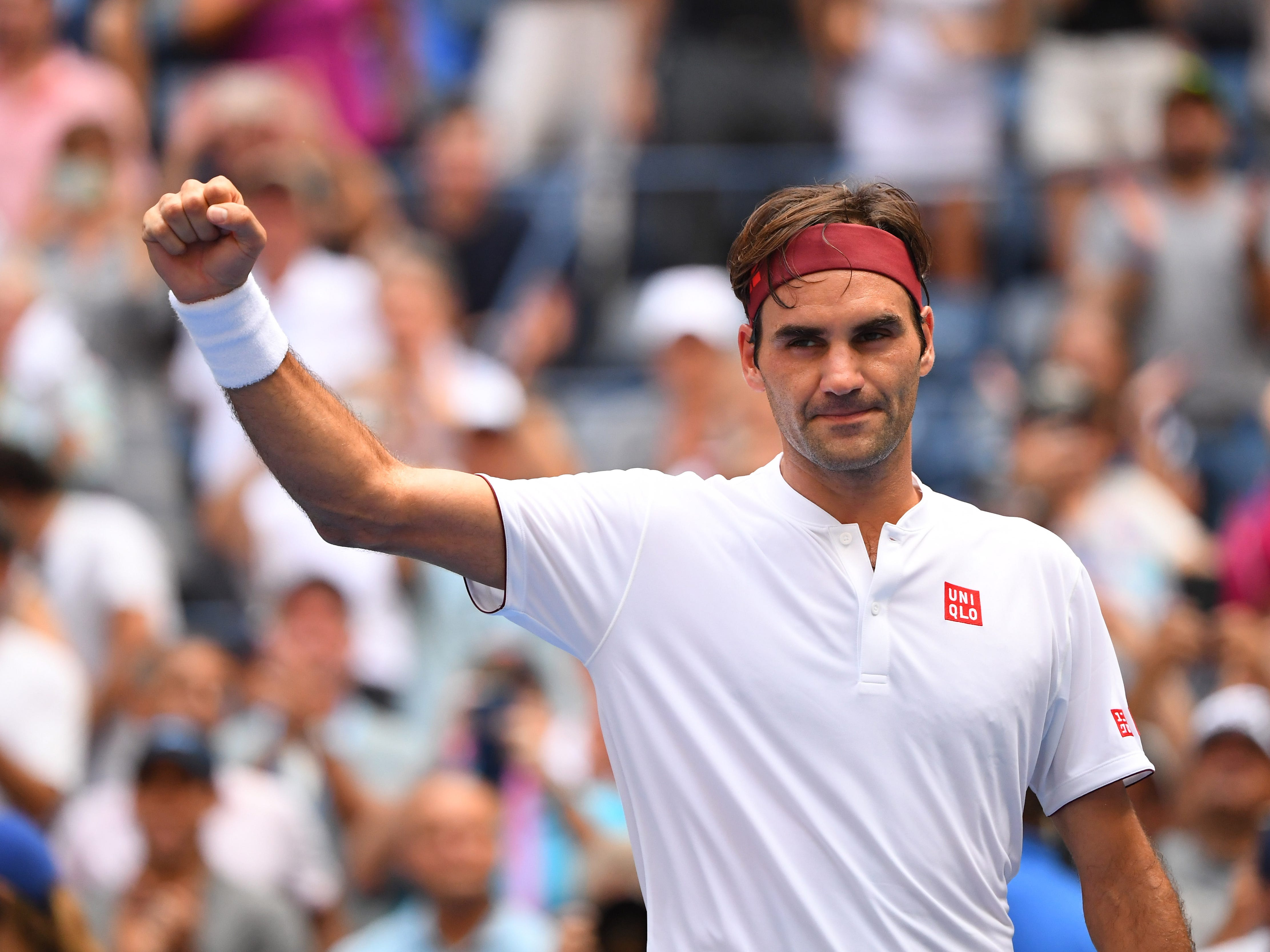 Roger Federer of Switzerland moves into the third round with a 7-5, 6-4, 6-4 win against Benoit Paire of France.