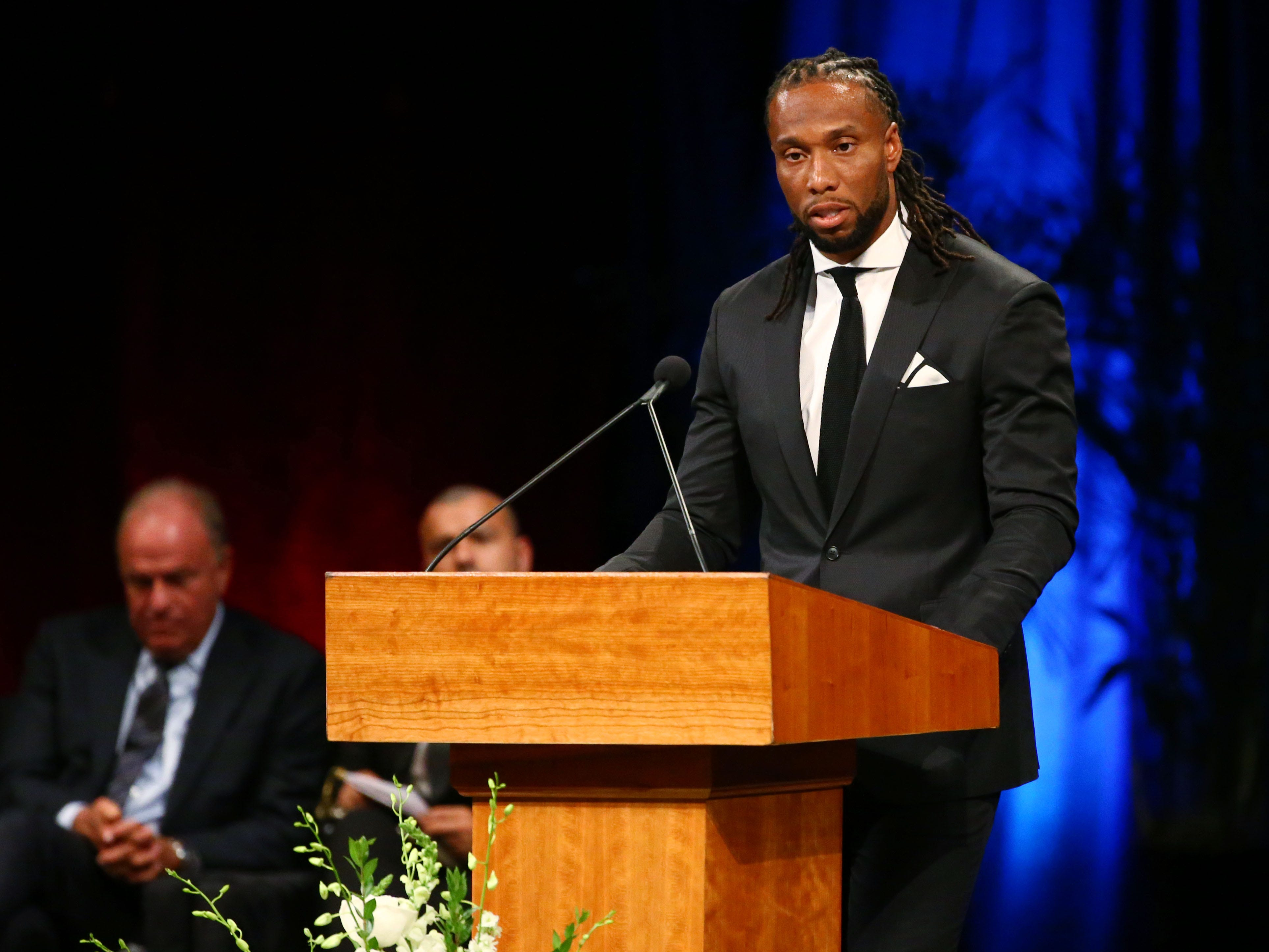 Arizona Cardinals wide receiver Larry Fitzgerald pays tribute to Sen. John McCain during a memorial service at North Phoenix Baptist Church, Aug. 30, 2018, in Phoenix.