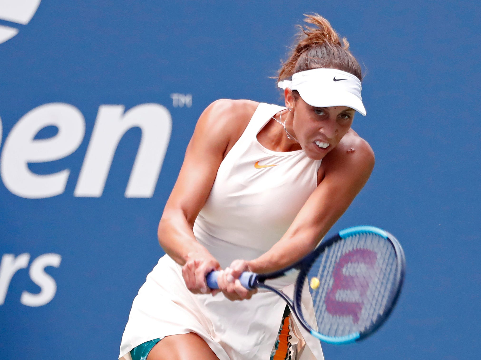 Madison Keys of the USA smacks smacks a backhand during her 6-4, 6-1 win against countrywoman Bernarda Pera.