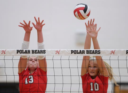 Neenah's Kiersten Kraus (13) and Kaitlyn Nelson (10) defend against Hortonville on Thursday.