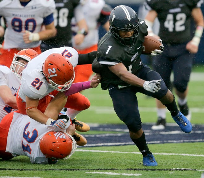 Wasonu Allen of Lawrence carries the ball against Macalester during a game last season on Ron Roberts Field at the Banta Bowl in Appleton.