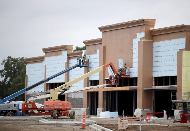 Construction continues at the WG&R Furniture building at the corner of West Wisconsin Avenue and Interstate 41 in Grand Chute.