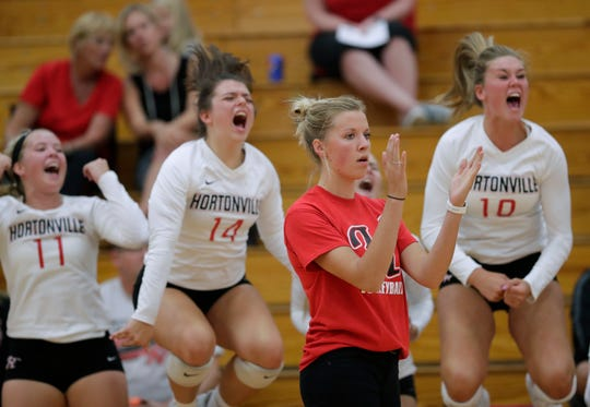 Hortonville's Carley Ramich applauds her team's winning point against Neenah on Thursday in Hortonville.