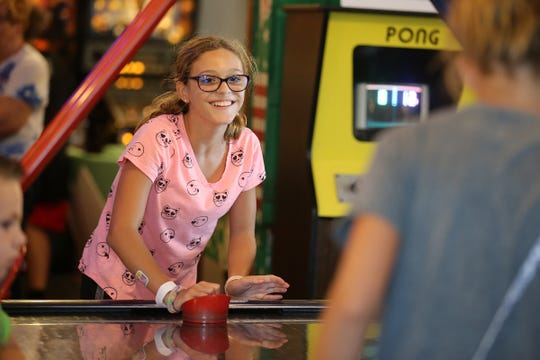 Sophia Gilli, 12, of Lawrenceville plays air hockey with friends at Silverball Museum in Asbury Park, NJ Friday August 31, 2018.