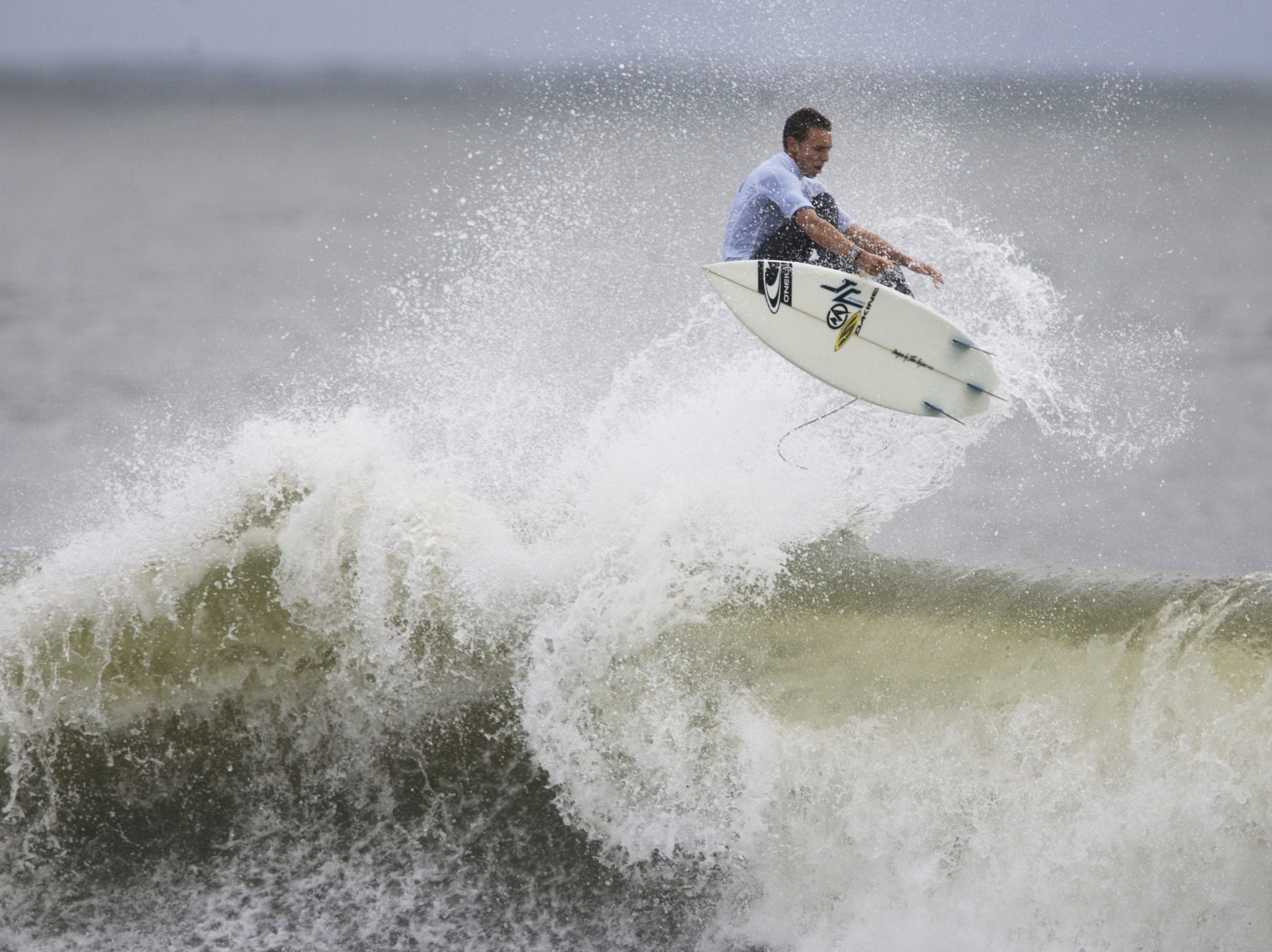Early heats of day one competition of the Foster's Belmar Pro & Fins Fast Jr. Pro take place at the 16th Ave beach in Belmar on Saturday, September 12, 2009. Brett Barley competes in the Jr. Pro division.  Doug Hood/ Asbury Park Press- Belmar, NJ- 09.12.09 (#5875)
