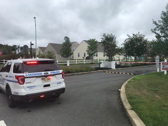 Friday, Aug. 31, 2018: A Lakewood police SUV blocks the gated entrance closest to a home on Eagle Ridge Circle where a couple was brutally beaten three days ago.