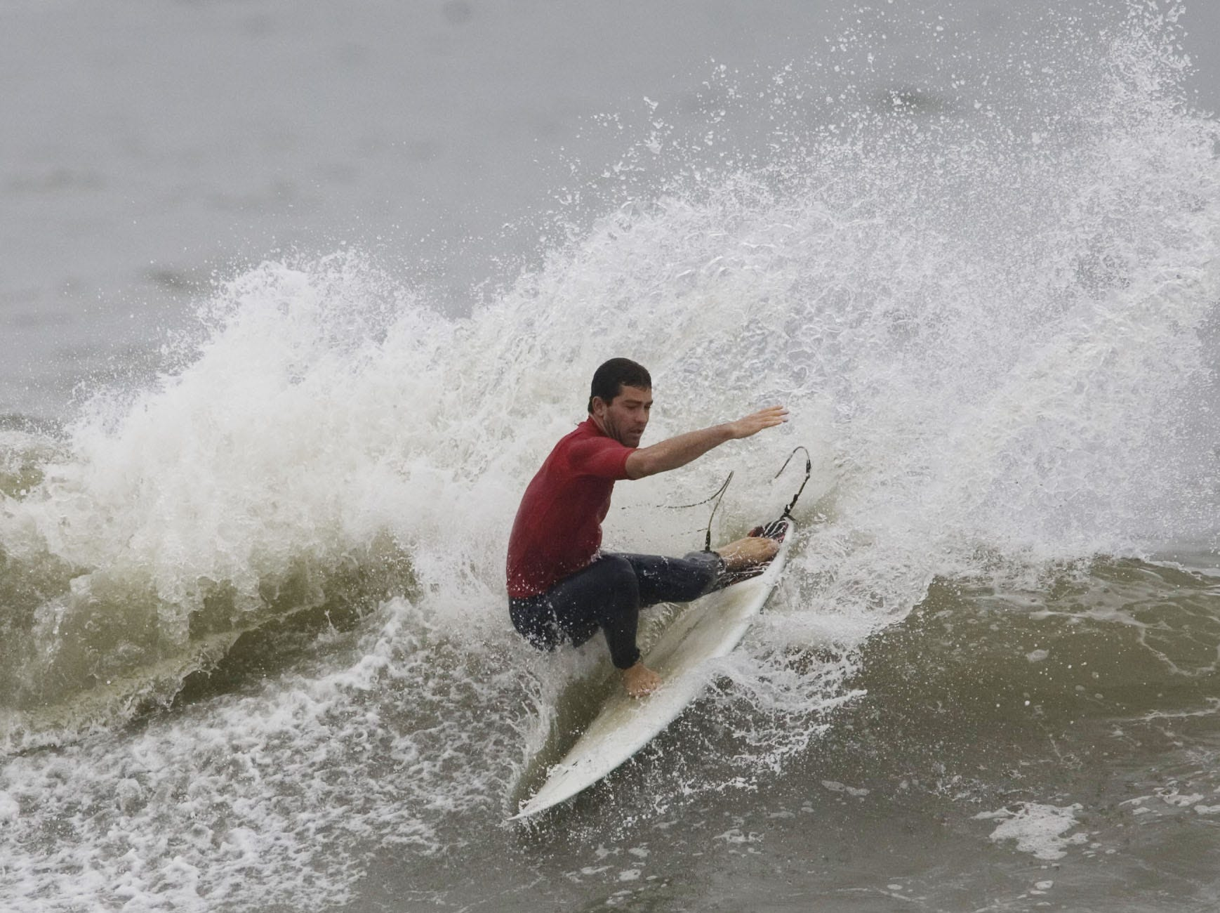 Early heats of day one competition of the Foster's Belmar Pro & Fins Fast Jr. Pro take place at the 16th Ave beach in Belmar on Saturday, September 12, 2009. Royce Weber of Surf City, Long Beach Island, competes in the mens division.  Doug Hood/ Asbury Park Press- Belmar, NJ- 09.12.09 (#5875)
