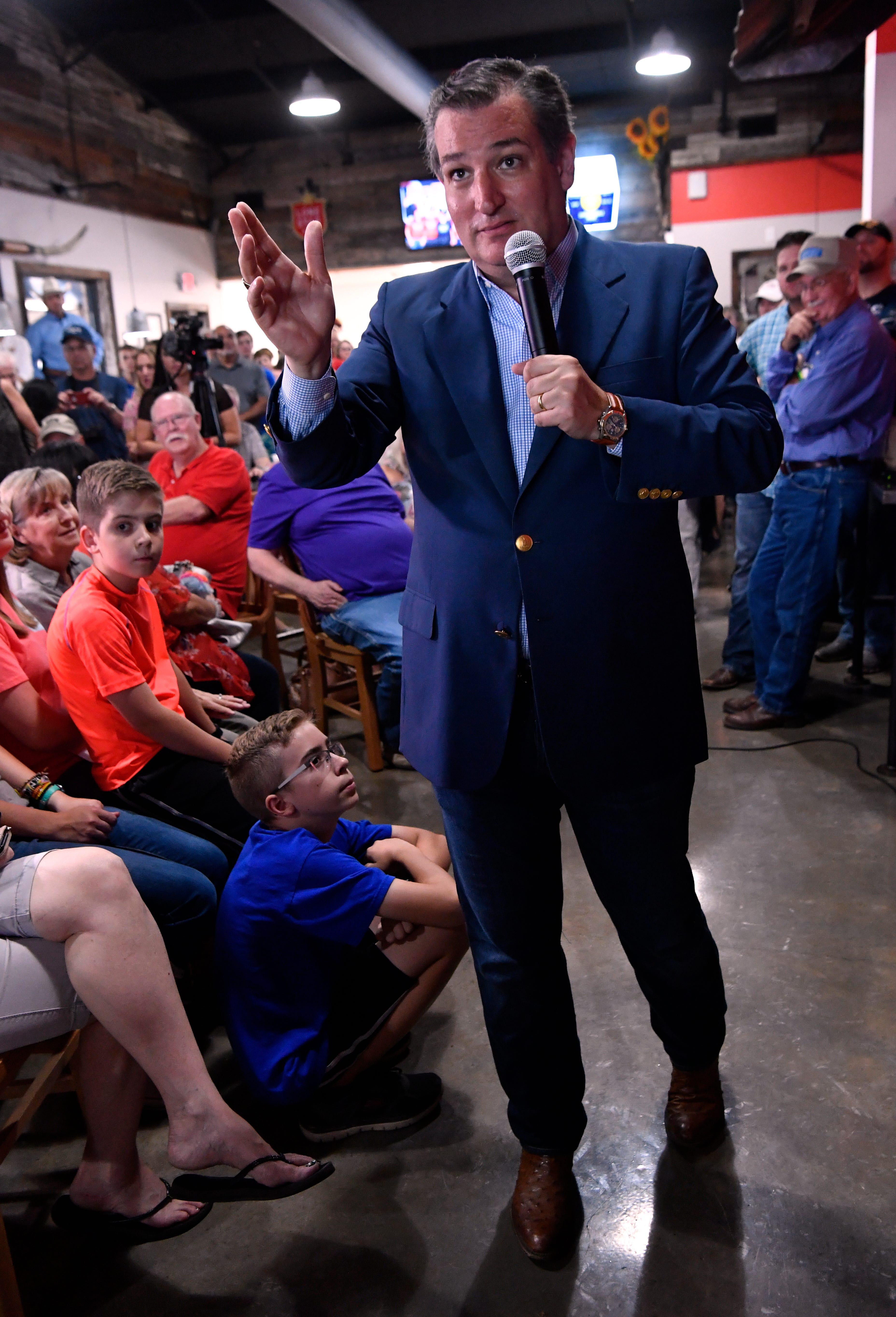 Addressing an audience member's question, U.S. Sen. Ted Cruz steps forward Thursday, Aug. 30, 2018, at Betty Rose's Little Brisket on Catclaw Drive. Over 200 packed the restaurant's indoor dining room.