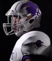 Hardin-Simmons linebacker Eriq Mitchell shows off the first new football helmet since 1990. The Cowboys announced the addition of the helmet and road white jersey in a video.