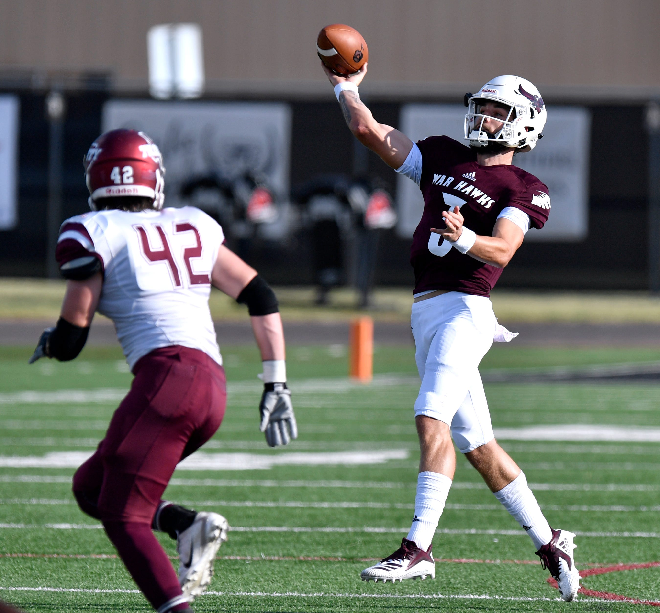 McMurry University quarterback Kevin Hurley, Jr. throws a pass during the War Hawks' game against Trinity University Thursday August 30, 2018.