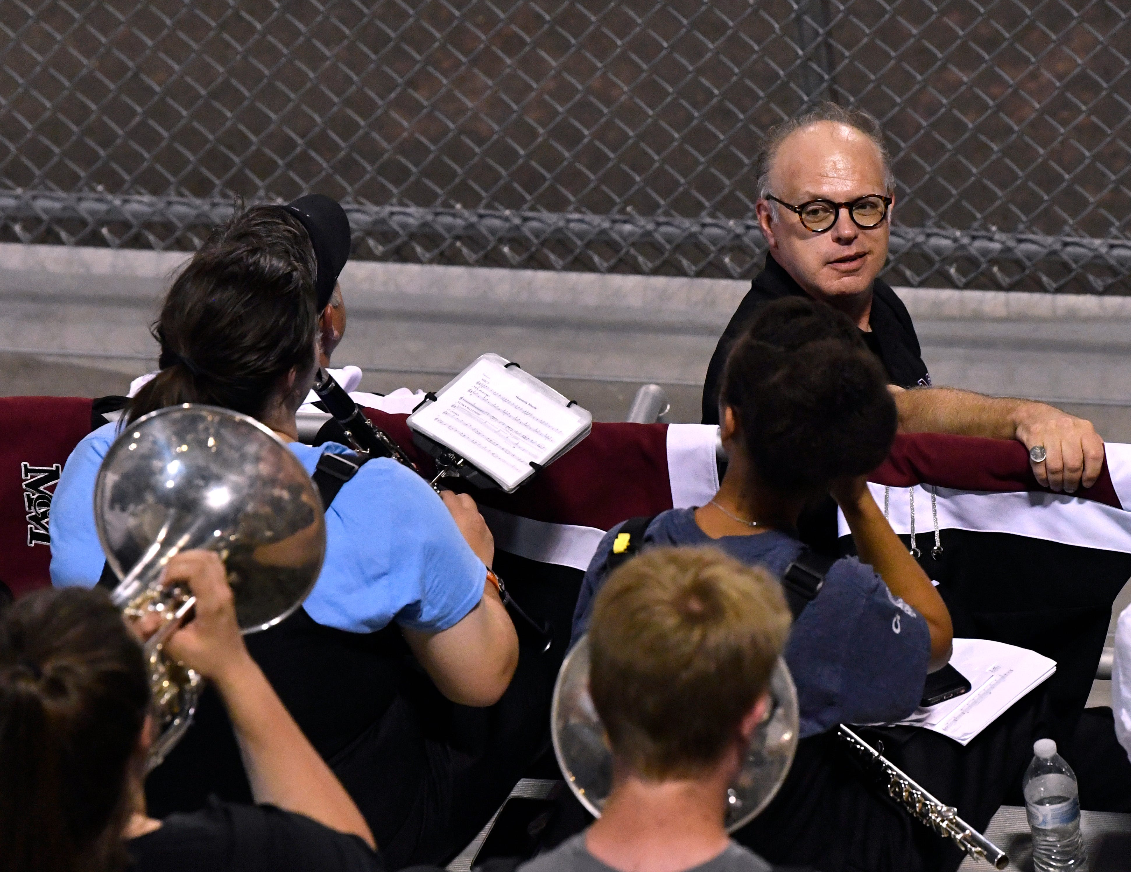 McMurry University's new director of bands, Dr. Patrick Fortney, listens to the War Hawk band during Thursday's football game against Trinity University.