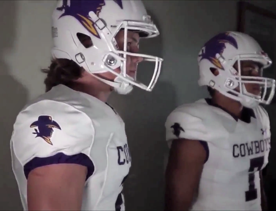 Hardin-Simmons captains Reese Childress, left, and Alex Bell model the new football jerseys and helmets in a video shown to the team at Shelton Stadium on Thursday, Aug. 30, 2018.