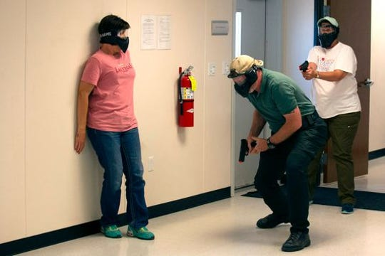 School teachers and administrators participate in an active shooter drill June 28 in Commerce City, Colorado.