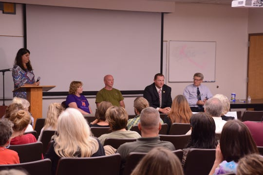 Presenters at the Aug. 28 community forum fielding audience questions. Pictured from left to right: Deputy Health Director Tammy Cody, Sherry and Rob Abbot, Chief Deputy Coy Phillips and Dr. Blake Fagan.
