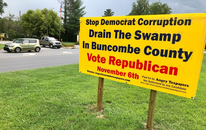 A series of federal indictments against former Buncombe County officials has spurred a new political action committee, Angry Buncombe Taxpayers, to started putting up signs like this one on U.S. 70 in Swannanoa. They calli for the ouster of Democrats from the Buncombe County Board of Commissioners.