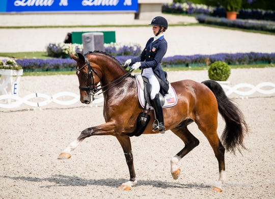 Rio Olympics bronze medalist Laura Graves rides her horse Verdades during a dressage competition