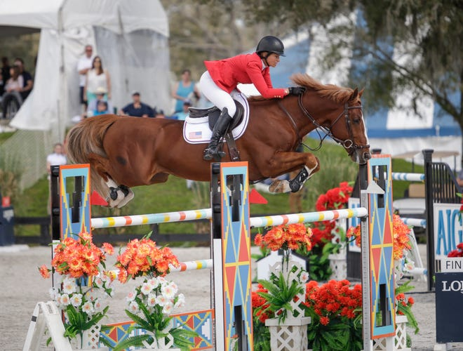 Beezie Madden and Darry Lou during Round 1 of FEI Nations Cup Jumping CSI5 at HITS Post Time Farm in Ocala, Florida. Show jumping is considered the most popular spectator equestrian event.