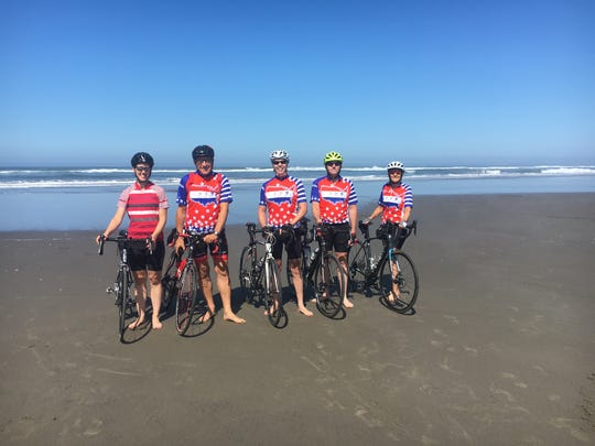 Brad Campbell, center, took a more than 3,000-mile bike ride across the country this summer with America by Bicycle, starting at the ocean in Astoria, Oregon.