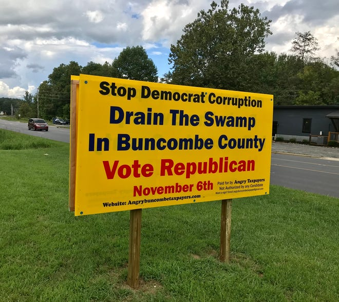 The political action committee Angry Buncombe Taxpayers has started putting up signs like this one on U.S. 70 in Swannanoa, calling for the ouster of Democrats from the Buncombe County Board of Commissioners.