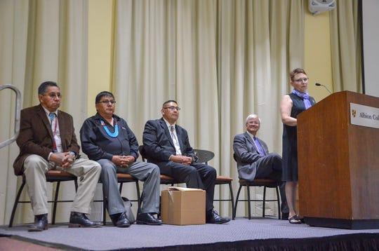 Professor Bille Wickre speaks to a crowd at Albion College on Thursday, Aug. 30, 2018, in honor of Zuni Tribal Councilman Carleton Bowekaty and two Zuni cultural practitioners, Nelson Vicenti and Octavius Seowtewa, who were visiting Albion College to retrieve a Zuni artifact.