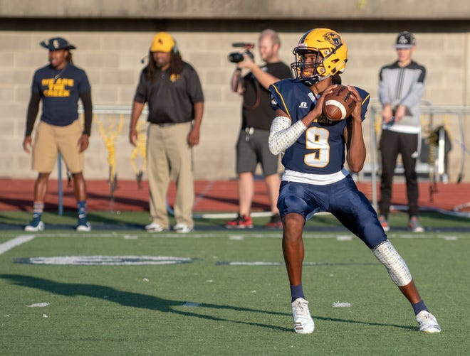 Central QB Jermaine Morris (9) drops back to pass during game action Thursday night.