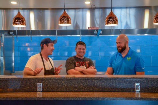 Trent Mead (left), the lead chef for Lucky Rooster Kitchen & Cocktails, talks with Mike Gothberg, the builder and designer, and Stephen Titus, who owns the building.