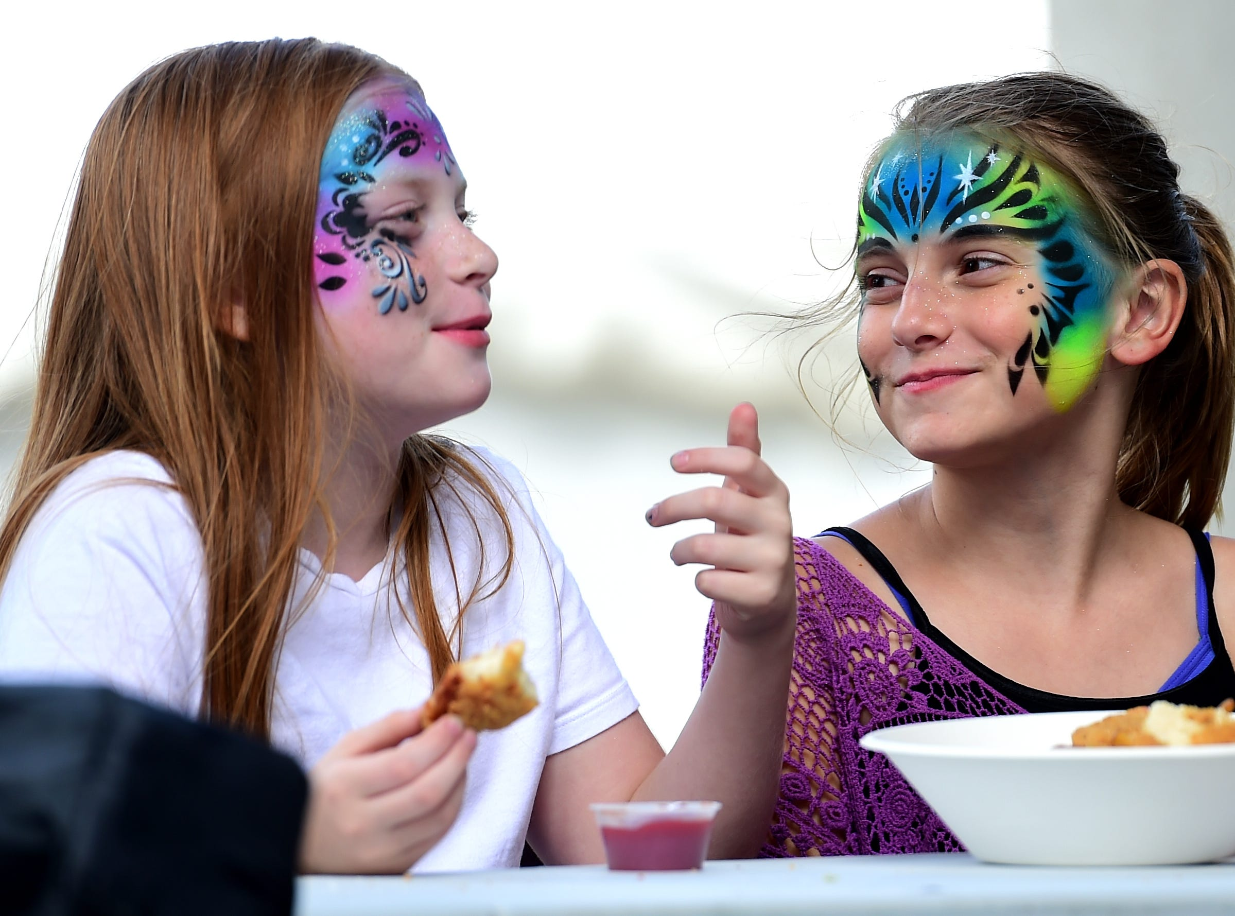 Stevie Tomas and Samantha Sloan of Liverpool eat during the Great New York State Fair. The Fair continues through Labor Day at the Fairgrounds near Syracuse, NY. August 30, 2018.