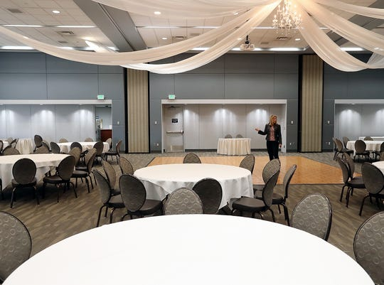 Lori Main, General Manager of the Kitsap Conference Center, moves through a banquet hall that is being set up for a wedding on Friday, August 31, 2018.