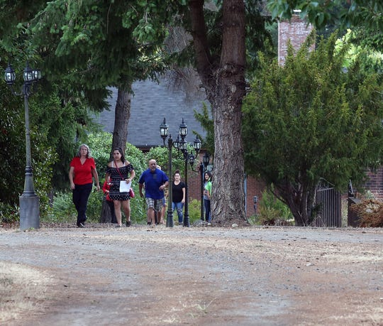 Students, parents and teachers walk at the new Chief Kitsap Academy campus near Poulsbo on Aug. 30.