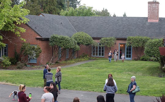 Parents, students and teachers mingle at the new Chief Kitsap Academy campus on Aug. 30.
