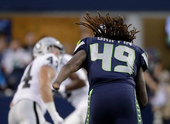 Seahawks linebacker Shaquem Griffin runs downfield during Thursday's preseason game in Seattle. Griffin is expected to start the team's season opener in place of injured K.J. Wright.