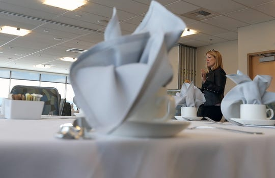 Lori Main, General Manager of the Kitsap Conference Center, talks about the different booking possibilities in the third-floor banquet room at the Kitsap Conference Center on Friday.