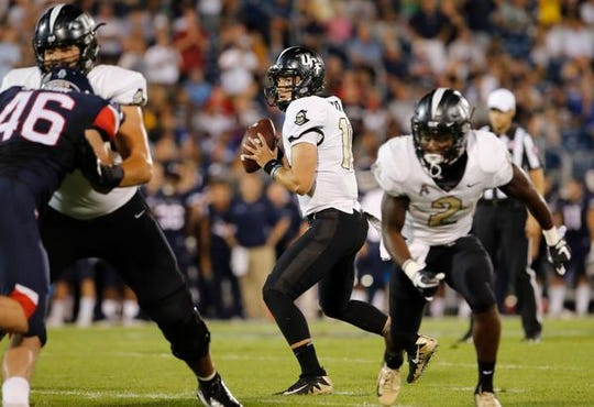 Aug 30, 2018; East Hartford, CT, USA; UCF Knights quarterback McKenzie Milton (10) looks to pass against the Connecticut Huskies in the second quarter at Pratt & Whitney Stadium at Rentschler Field. Mandatory Credit: David Butler II-USA TODAY Sports