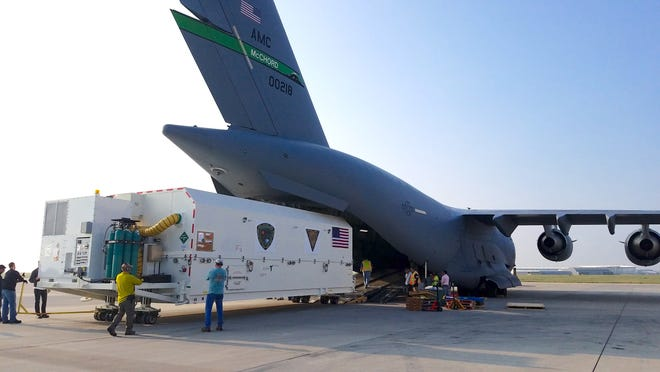 Lockheed Martin's first next-generation GPS III spacecraft is loaded into an Air Force C-17 Globemaster III at Buckley Air Force Base in Colorado on Aug. 20 before its flight to Cape Canaveral.