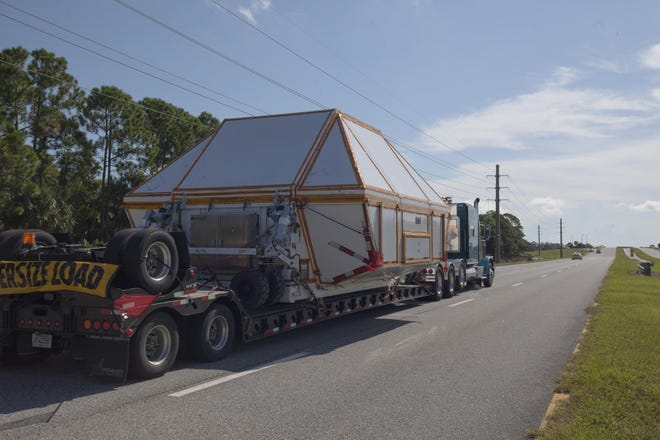 The Orion crew module pressure vessel for Exploration Mission-2 arrives at Kennedy Space Center on Aug. 24, 2018.