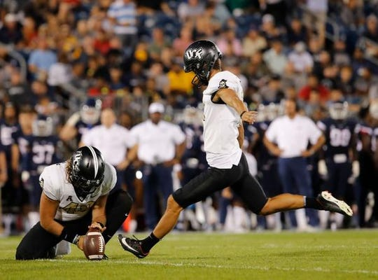Aug 30, 2018; East Hartford, CT, USA; UCF Knights place kicker Matthew Wright (11) makes the extra point against the Connecticut Huskies in the second quarter at Pratt & Whitney Stadium at Rentschler Field. Mandatory Credit: David Butler II-USA TODAY Sports